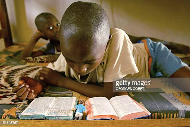 Children read the Bible at a missionary orphanage and creche of Spanish REMAR organization headed by Spanish Diego Lara Gonzales 03 October 2002, in...