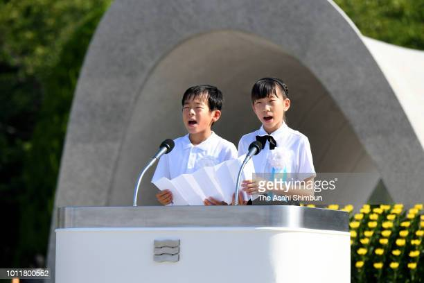 Children read the oath for peace during the Peace Memorial Ceremony at Hiroshima Peace Memorial Park on August 6 2018 in Hiroshima Japan The first...