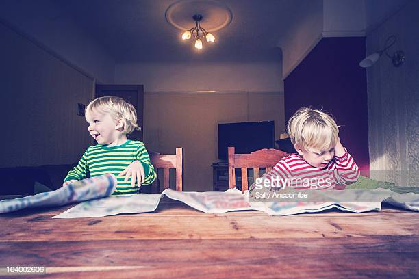 Children reading newspapers
