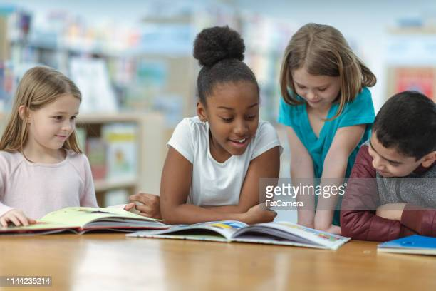 children reading - reading stock pictures, royalty-free photos & images