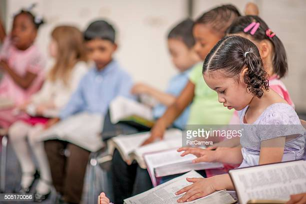 Children Reading Scripture at School