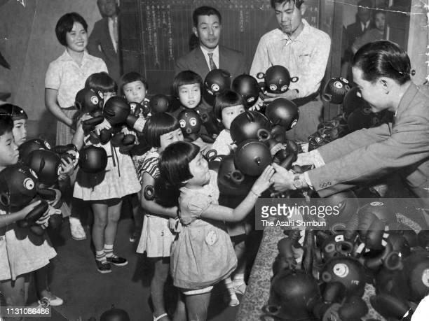 Children receive Dakkochan dolls on September 26 1960 in Osaka Japan