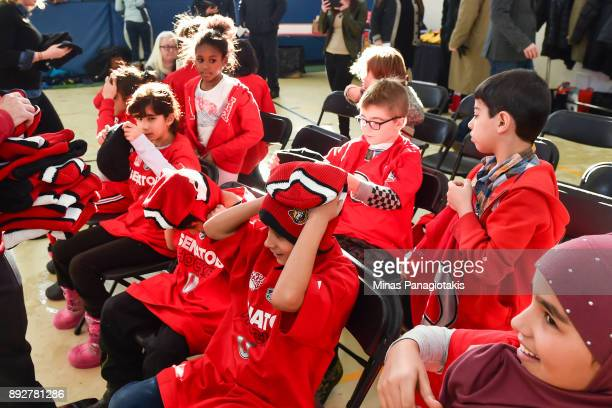 Children receive hats and shirts during the 2017 Scotiabank NHL100 Classic Legacy Project press conference at the Boys Girls Club Police Youth Centre...