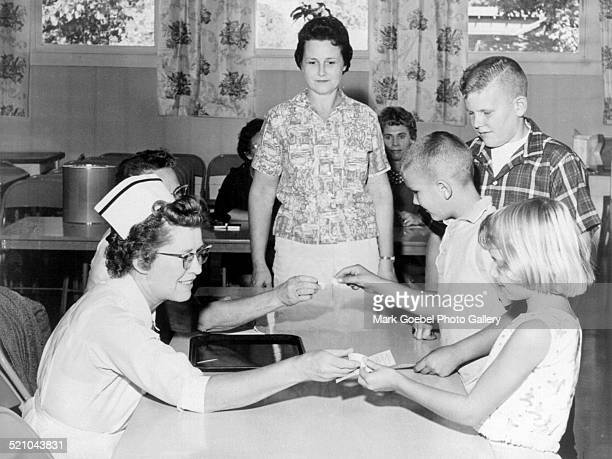 Children receiving sugar cube polio vaccine early 1960s