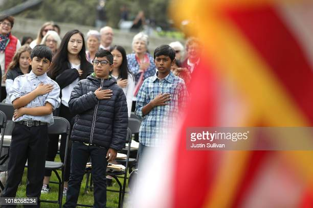 Children recite the Pledge of Allegiance during a naturalization ceremony for kids between the ages of 612 at Crissy Field near the Golden Gate...