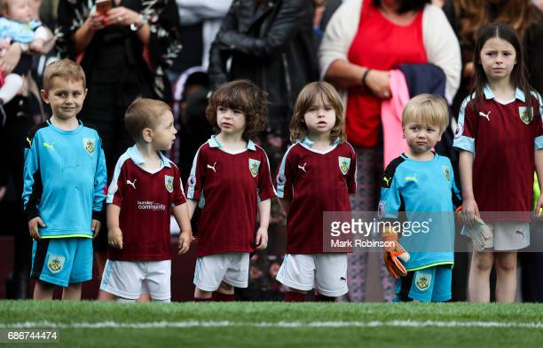 Children related to the team members of Burnley line up to go on the pitch at the end of the Premier League match between Burnley and West Ham United...
