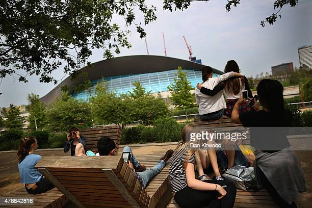 Children relax along the canal at near the aquatics centre in the Olympic Park on June 12 2015 in London England The MET Office predicted that parts...