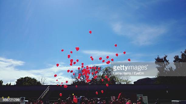 children releasing red balloons during traditional festival - releasing stock pictures, royalty-free photos & images