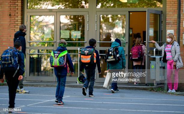 TOPSHOT Children respect social distancing rules as they enter the Petri primary school in Dortmund western Germany on May 7 as the school reopens...
