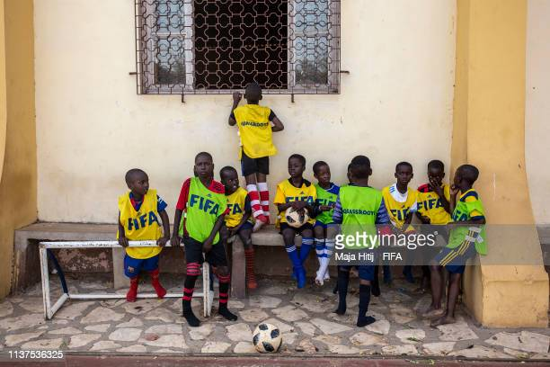 Children rest after playing football during a FIFA Grassroots schools program on January 18 2019 in Dakar Senegal