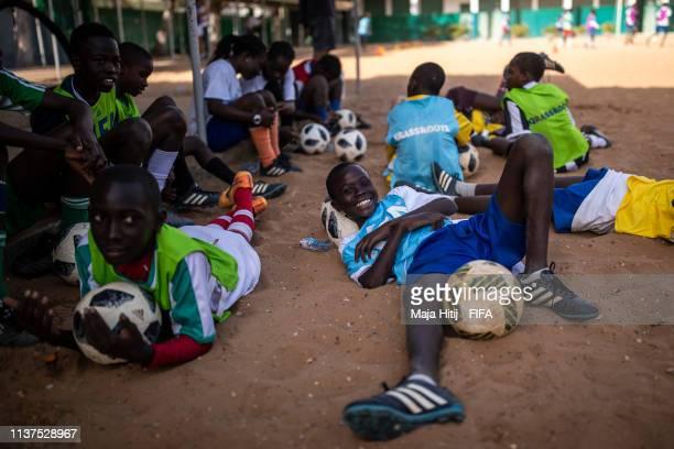 Children rest during a FIFA Grassroots schools programme on January 15 2019 in Dakar Senegal
