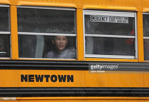 Children return to school on December 18 2012 in Newtown Connecticut Four days after 20 children and six adults were killed at Sandy Hook Elementary...
