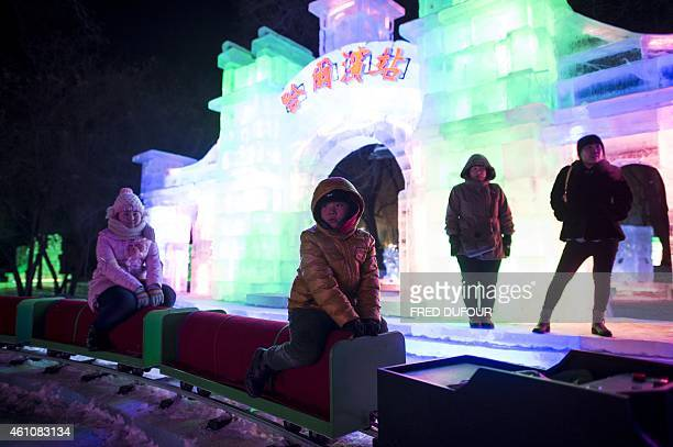 Children ride a little train while visiting the Zhaolin Park on January 6 2015 during the 16th Harbin International Ice and Snow Festival in Harbin...