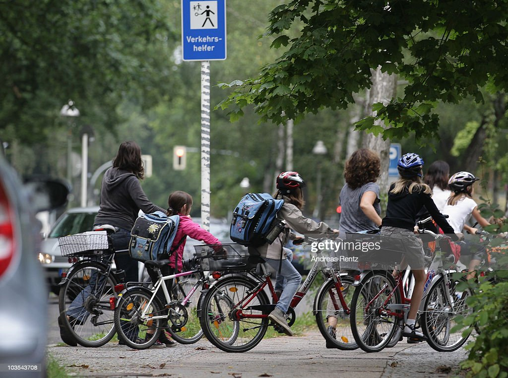Children ride bicycles on their way to school on the first school day on August 23, 2010 in Berlin, Germany. Many German school districts, including those in Berlin, are reducing the school times pan from 13 to 12 years as part of a nationwide set of primary and secondary school reforms.