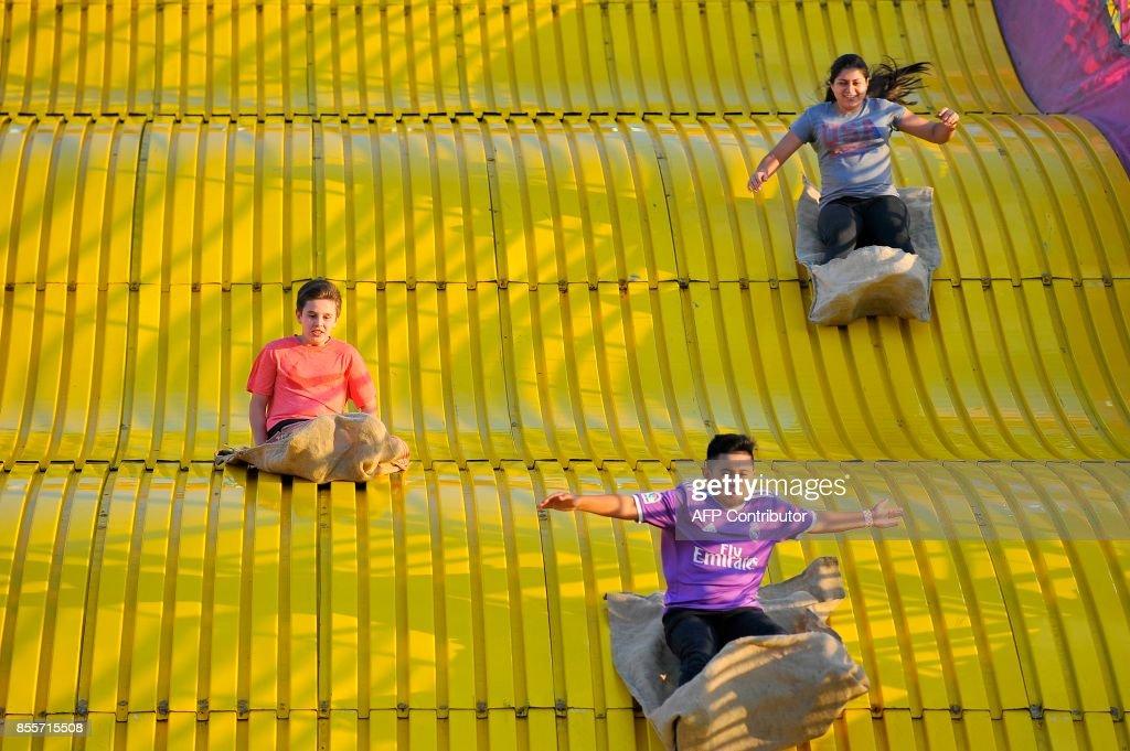 Topsfield Fair 2020.Children Ride Down A Giant Slide At The 199th Topsfield Fair