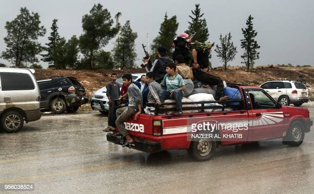 Children ride in the back of a pickup truck with Turkeybacked fighters as they drive in Abu alZandin checkpoint near alBab in northern Syria on May 8...