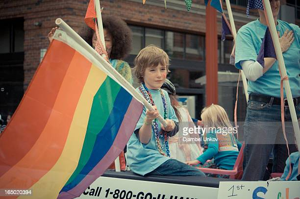 CONTENT] Children ride in the back of a truck to show their support for gay rights at the Portland Oregon Gay Pride Parade during Gay Pride Week The...