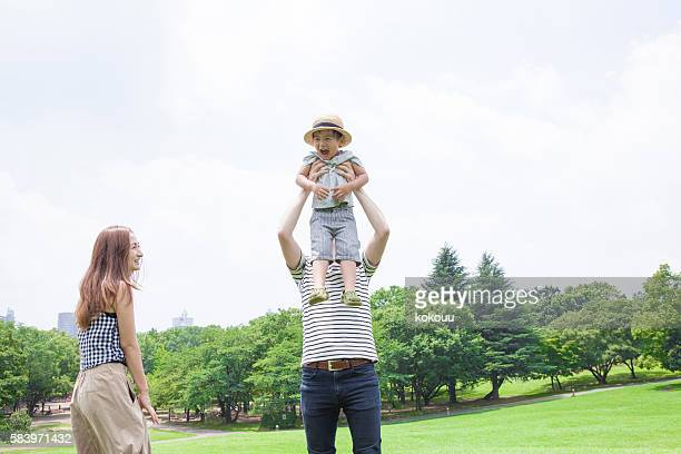 Children riding on his father's shoulder