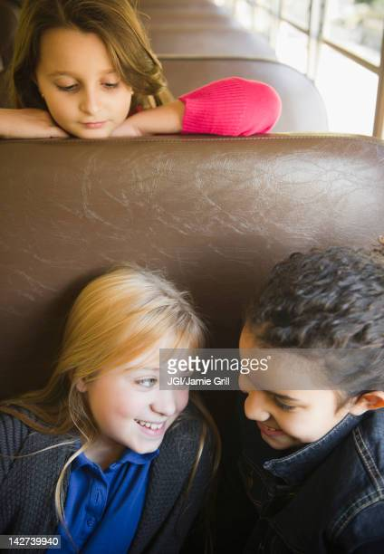 children riding on school bus - montclair stock pictures, royalty-free photos & images