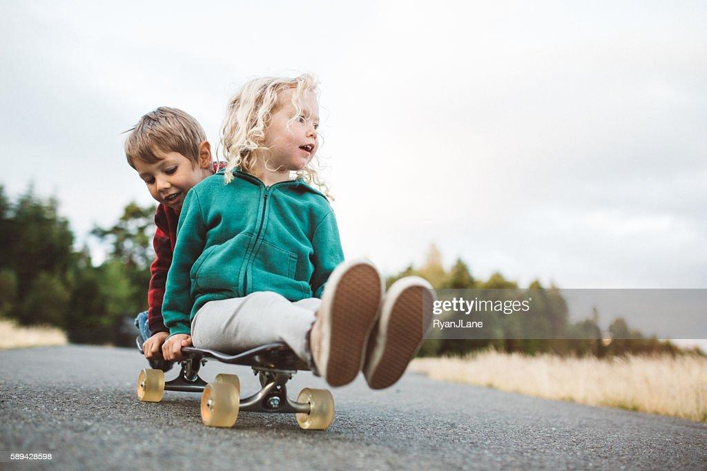 Children Riding on Skateboard : Stock-Foto
