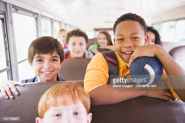 children riding school bus - vehicle interior stock pictures, royalty-free photos & images
