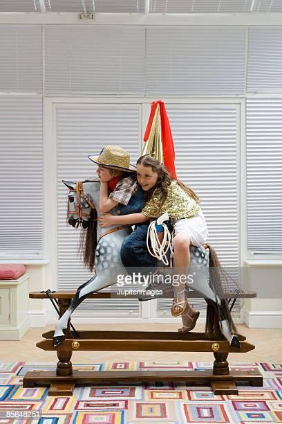 Children riding toy horse