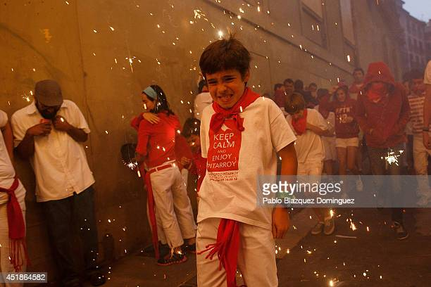 Children run behind the Toro del Fuego during the third day of the San Fermin Running Of The Bulls festival on July 8 2014 in Pamplona Spain The...