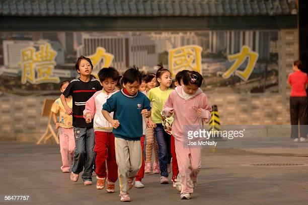 Children run during training at Shi Chahai September 23, 2005 in Beijing, China. Established in 1958, Shi Chahai has built a world class reputation...