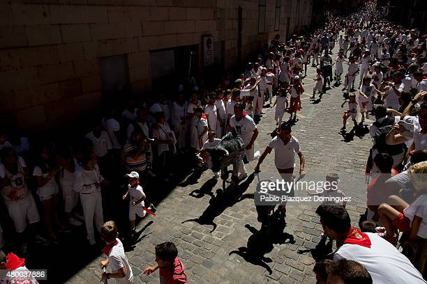 Children run in front of toy bulls during the Encierro Txiki during the fourth day of the San Fermin Running Of The Bulls festival on July 9 2015 in...