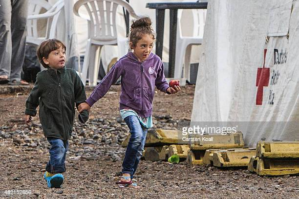 Children run inside a temporary tent camp on July 27 2015 in Dresden Germany The German Red Cross set up the camp last week and plan to house 800...