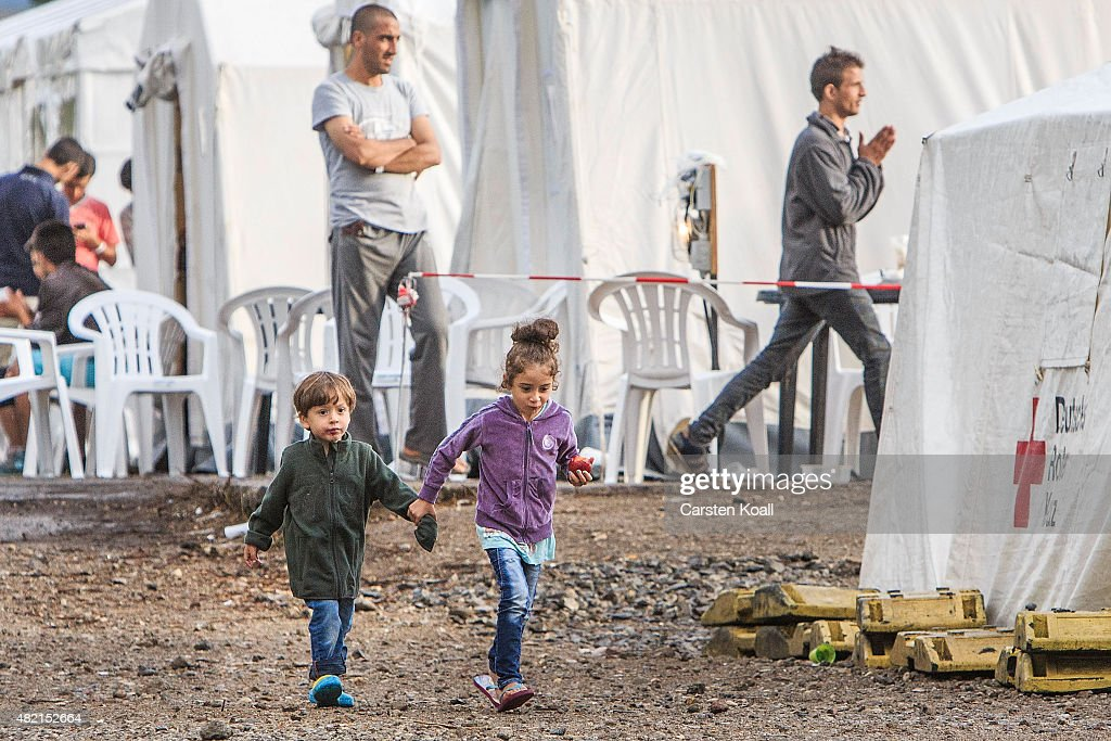 Refugees Arrive In Dresden Amidst Protests : News Photo