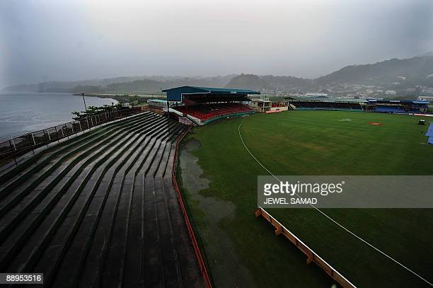 Children run off the field during a downpour on the first day of the first Test match between West Indies and Bangladesh at the Arnos Vale Ground in...