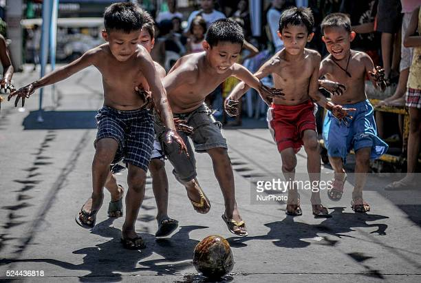 Children run to snatch a coconut during parlour games as part of the feast day of Saint Rita of Cascia in Paranaque Metro Manila Philippines May 18...