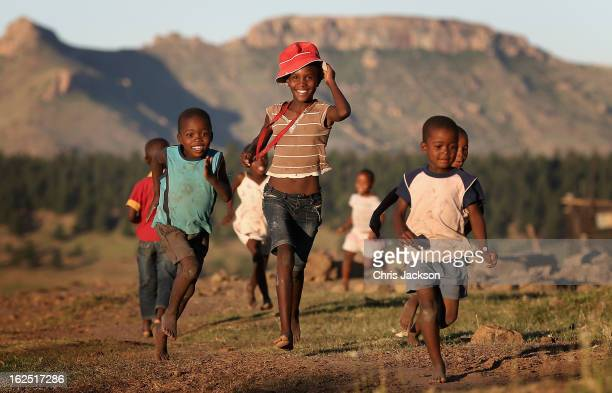 Children run towards charity workers from Sentebale on February 23 2013 in Morija Lesotho Sentebale is a charity founded by Prince Harry and Prince...