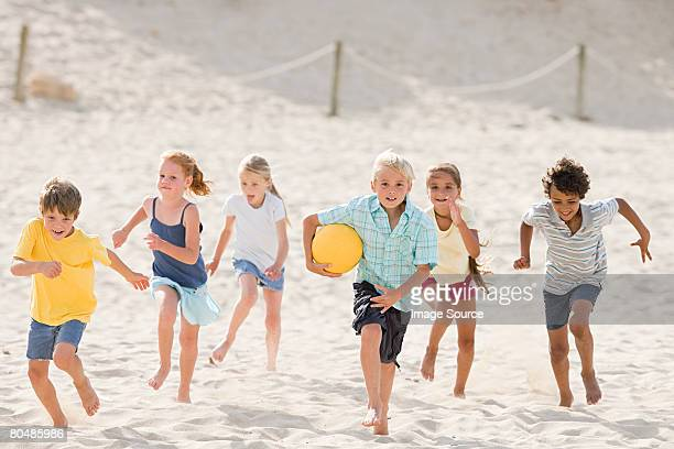 Children Running Across Beach