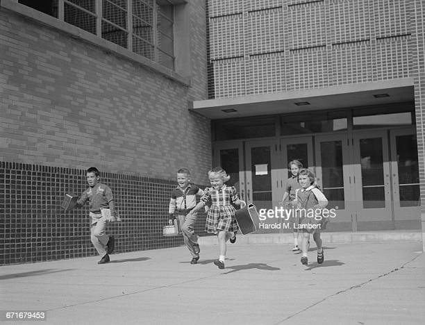 children running and holding school bag - {{relatedsearchurl(carousel.phrase)}} stock pictures, royalty-free photos & images