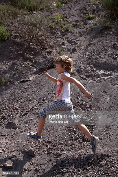 children running at the Mount Vesuvius