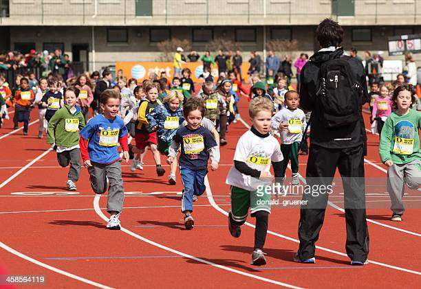 children running at track & field youth clinic - eugene oregon stock pictures, royalty-free photos & images