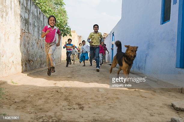 Children running in a street, Hasanpur, Haryana, India