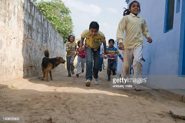 Children running in a street, Hasanpur, Haryana, India