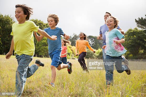 Children running in park