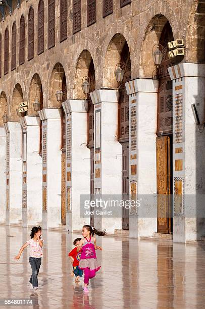 Children running in Umayyad Mosque, Damascus, Syria