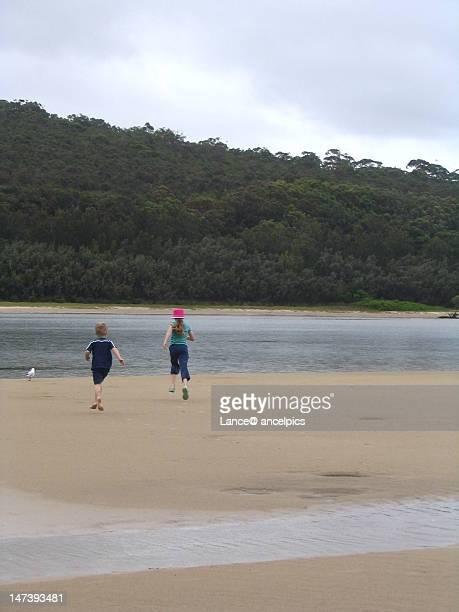 Children running near river