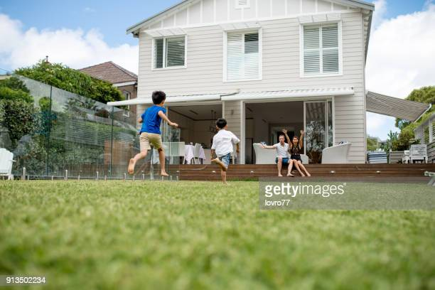 children running on backyard - domestic garden stock pictures, royalty-free photos & images