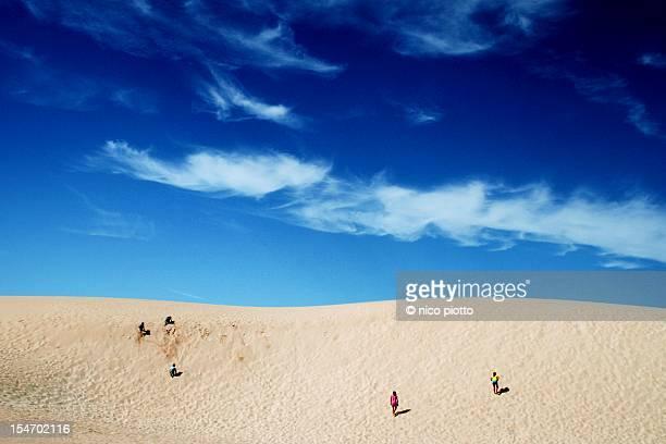Children running on dunes of Fuerteventura Desert