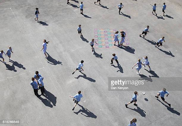 children running on playground - school child stock pictures, royalty-free photos & images