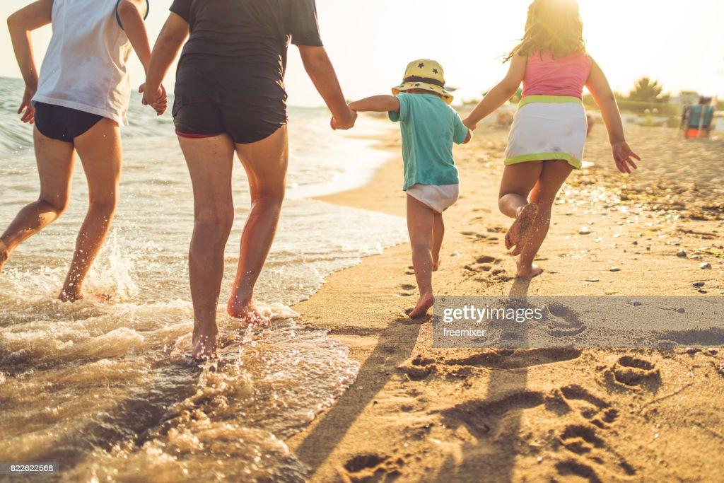 Children running on the beach : Stock Photo