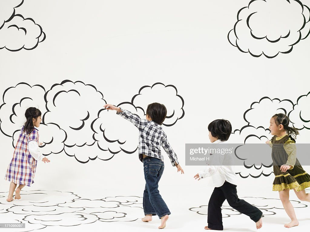 children running  on the clouds : Stock Photo