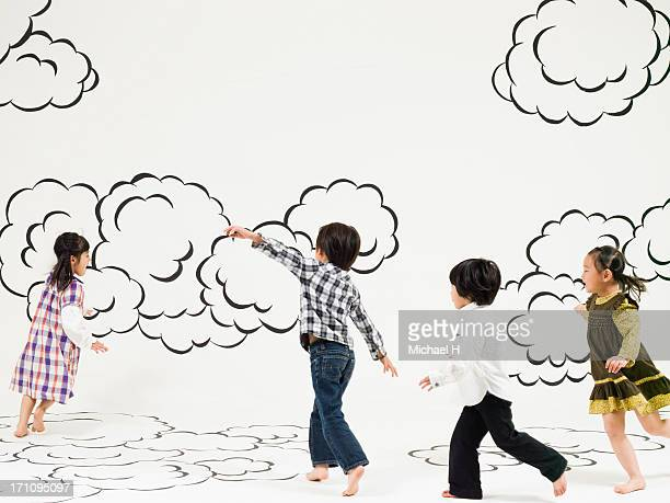 children running  on the clouds