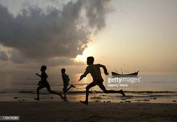 Children running through the beach at Saint Martins Island Locally known as Narikel Jinjira it is the only coral island of Bangladesh located in the...